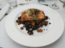 Grilled filet of Atlantic Salmon: Beluga lentils & butternut squash hash with dried currants, garbanzo beans, spinach and sage, beurre blanc sauce