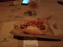 The standard brat with sauerkraut and sweet peppers