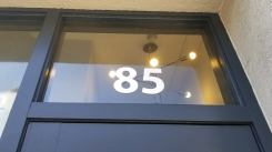 the number 85 printed on the glass at Cross Campus