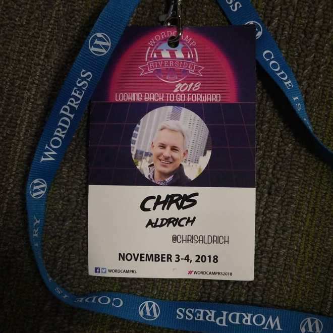WordCamp Riverside 2018 badge with the theme Looking back to go forward