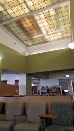 Green glass ceiling panels let light into the library