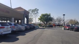 Oblique view of the front of the shopping center where The Habit has a corner location