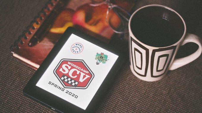 WordCamp Santa Clarita 2020 logo on ereader next to a coffee cup