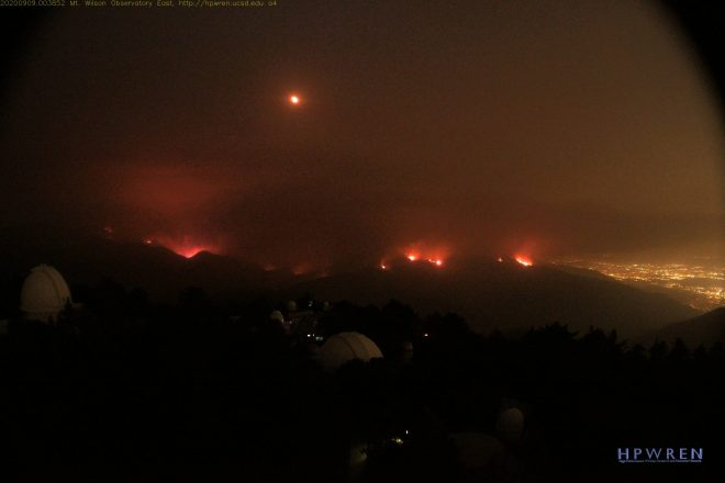 Night photo of flames burning near the Mt. Wilson Observatory.