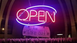 Neon open sign with handwritten addendum for *take out* at Domenico's