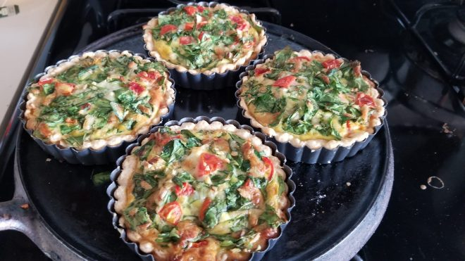 four individual baked quiches