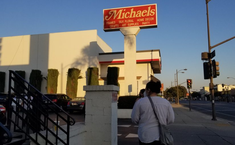sun setting on the Michaels sign in Pasadena