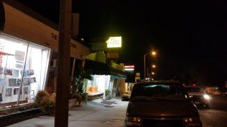 nighttime view of Eggroll Express walking East on the sidewalk