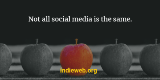 "black and white photo of apples with the one in the middle being red. Overlaid texts reads ""Not all social media is the same. indieweb.org"""