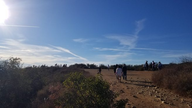 View of a reasonable crowd of people at the end of the trail at Inspiration point