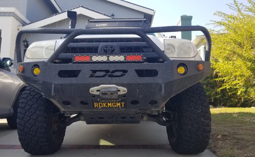 tricked out Toyota SUV meant for offroading featuring a front license plate ROKMGMT