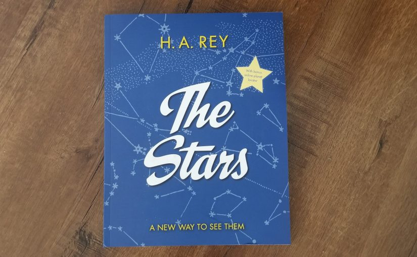 H.A. Rey's book The Stars featuring a blue cover with constellations and a large yellow star in the corner