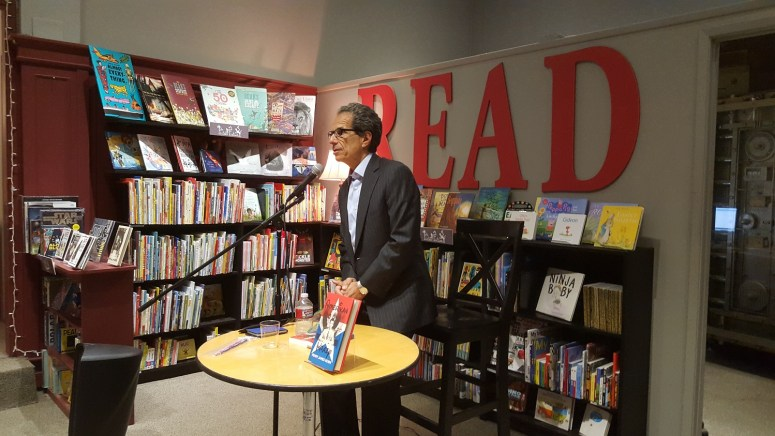 Bert Deixler, a law partner at Kendall Brill Kelly LLP and co-owner of Chevalier's, welcomed guests and introduced Amerikan Krazy's publisher, Chris Aldrich of Boffo Socko Books, as well as author Henry James Korn.
