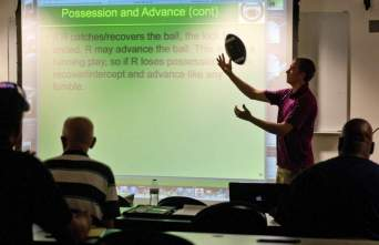 Washington District Football Officials Association (WDFOA) trainer Pat Kepp leads a session Monday for officials at Georgetown Prep. Tom Fedor/The Gazette