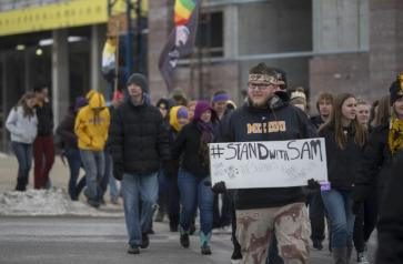 Tyler Swank marches with students in support of Michael Sam on Saturday. The One Mizzou, One Wall event was organized to support Sam in the face of picketing from the Westboro Baptist Church. MICHAEL CALI /The Maneater