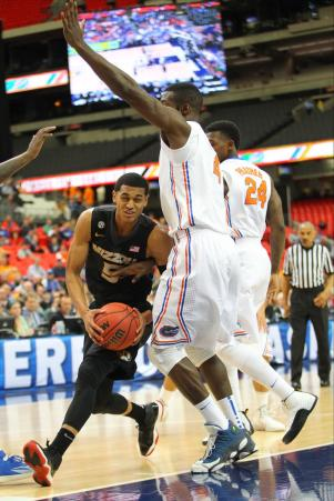 Missouri Tigers guard Jordan Clarkson (5) drives past Florida Gators center Patric Young (4) during the third-round SEC Tournament game between Missouri and Florida on Friday, March 14, 2014, at the Georgia Dome in Atlanta. TIM TAI/The Maneater