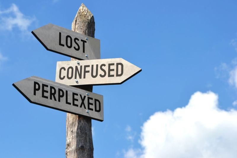 sign post with: lost, confused and preplexed signs