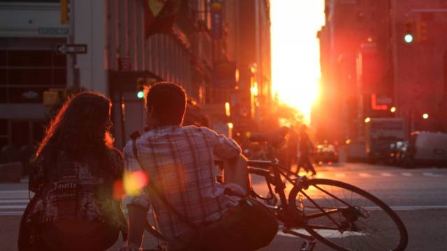 8858655-couple-sitting-on-edge-of-road--1920x1080