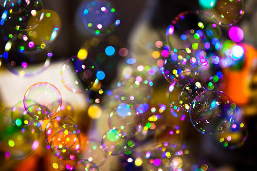 Lots of bokeh exploding from the bubble gun.