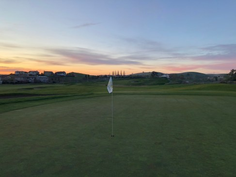 Sunrise coming up on the first green.