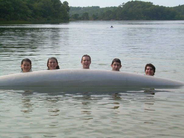 The siblings in the lake after flipping the canoe.