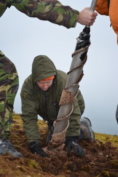 Moss banks are frozen from a depth of about 30 cm so coring requires a specially adapted permafrost corer. Photo credit: Dan Charman.
