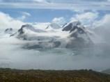 Low cloud swirls around the mountainous terrain and high-elevation moss banks of Elephant Island, South Shetland Islands. Photo credit: Dan Charman.