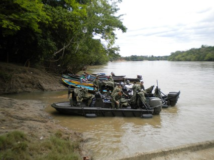 Military partrolling for paramilitaries on the river