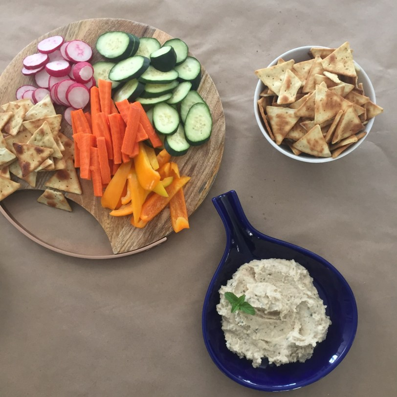 white bean dip appetizer with veggies and pita chips