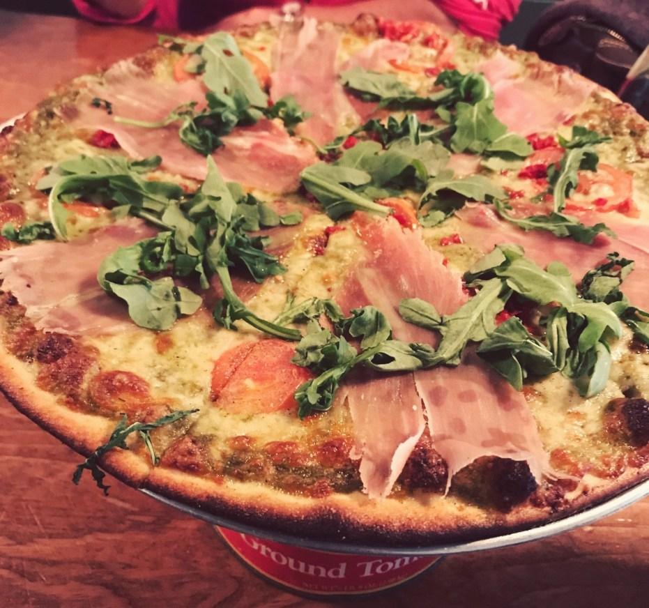 pesto schiutto pizza at greenville avenue pizza company
