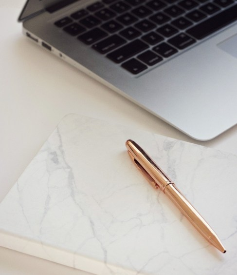 marble notepad and computer with rose gold pen