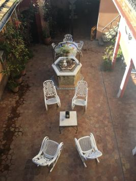 The essentials - rocking chair. The courtyard at Maria's casa