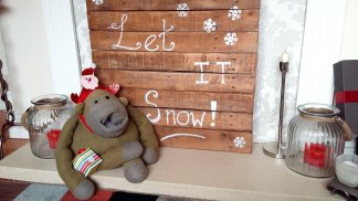 On Day 11 Monkey sings Let it Snow, with a handy prompt board next to him