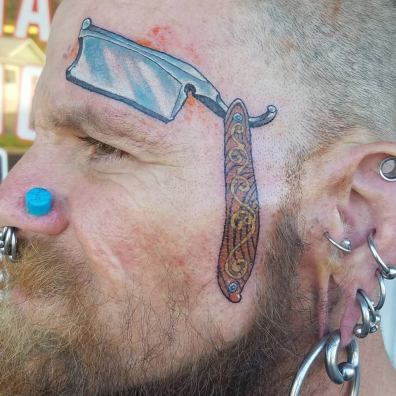 straght razor face tattoo