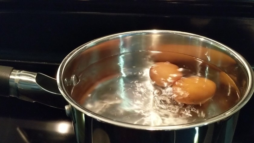 Put the eggs into a large heavy pot and cover them with 1 1/2 inches of cold tap water.