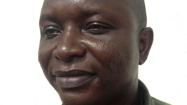Sheik Umar Khan, head doctor fighting the deadly tropical virus Ebola in Sierra Leone, poses for a picture in Freetown, June 25, 2014.