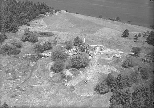 http://commons.wikimedia.org/wiki/Category:Oak_Island,_Nova_Scotia#mediaviewer/File:Digs_and_Buildings,_photo_2,_Oak_Island,_Nova_Scotia,_Canada,_August_1931.jpg