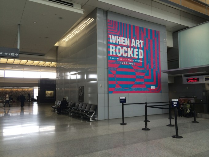 """Signage for """"When Art Rocked"""" at San Francisco International Airport."""