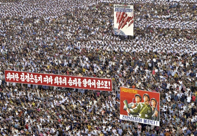 """People attend a mass rally against """"U.S. Imperialists"""" at Kim Il Sung Square in Pyongyang in this undated photo released June 25, 2014. REUTERS/KCNA"""