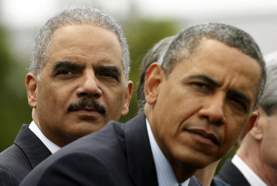 U.S. Attorney General Eric Holder, left, with President Obama. Photo: Reuters.
