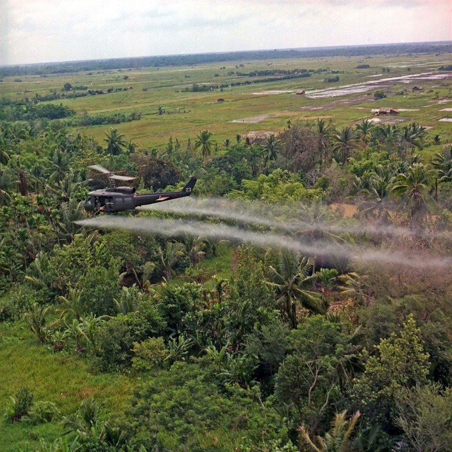 A U.S. UH-1D helicopter from the 336th Aviation Company sprays a defoliation agent on a dense jungle area in the Mekong delta, Vietnam, date unknown. Vietnam marks the 40th anniversary of the capture of Saigon by North Vietnamese forces on April 30, the event that ended a war that lasted over 30 years, killing up to four million Vietnamese, the Vietnamese government said, and more than 58,000 U.S troops, the U.S. Defense Ministry has said. Vietnam refers to the event as the date of its reunification. REUTERS/Courtesy U.S. Department of Defense - RTX1AW3X