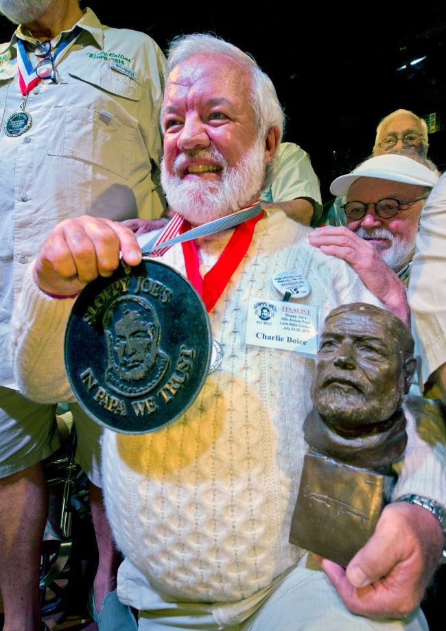 "In this Saturday, July 25, 2015 photo provided by the Florida Keys News Bureau, Charlie Boice beams after winning the 2015 ""Papa"" Hemingway Look-Alike Contest at Sloppy Joe's Bar in Key West, Fla. Boice finally won the contest after 15 attempts, beating out 121 other entrants following two preliminary rounds, semi-finals and two final rounds. The competition was a facet of the subtropical island's annual Hemingway Days festival that ends Sunday, July 26. Ernest Hemingway lived and wrote in Key West throughout the 1930s. (Andy Newman/Florida Keys News Bureau)"