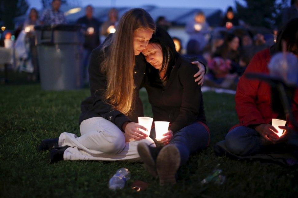 Heidi Wickersham (L), 31, comforts her sister Gwendoline Wickersham, 28, after the Umpqua massacre. REUTERS