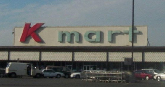 Mark Davis worked at a Kmart in Naperville, IL in the late 1980s and early 1990s. Each month, the corporate office mailed a cassette tape to all the s