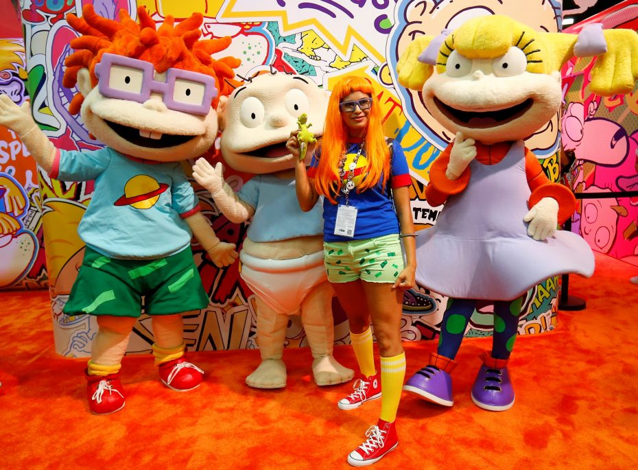 Attendee Stacy Hunter of Temecula poses with Rugrats characters while on the convention floor during opening day of Comic-Con International in San Diego, California, United States July 21, 2016.    REUTERS/Mike Blake - RTSJ3JO