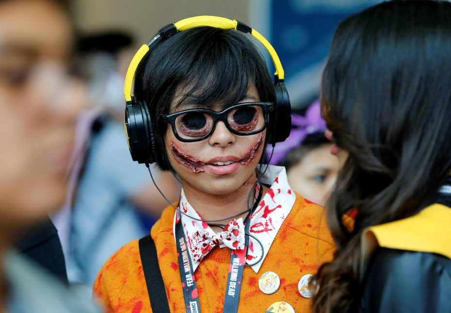 Lauren Lim chats with her friend as she attends the pop culture event Comic-Con International in San Diego, California, United States July 22, 2016.    REUTERS