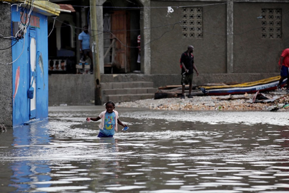 A girl walks in a flooded area after Hurricane Matthew in Les Cayes, Haiti, October 5, 2016. REUTERS/Andres Martinez Casares - RTSQVN6