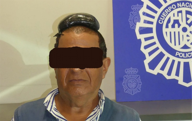 Drug smuggler busted with half a kilo of cocaine under his bad toupe