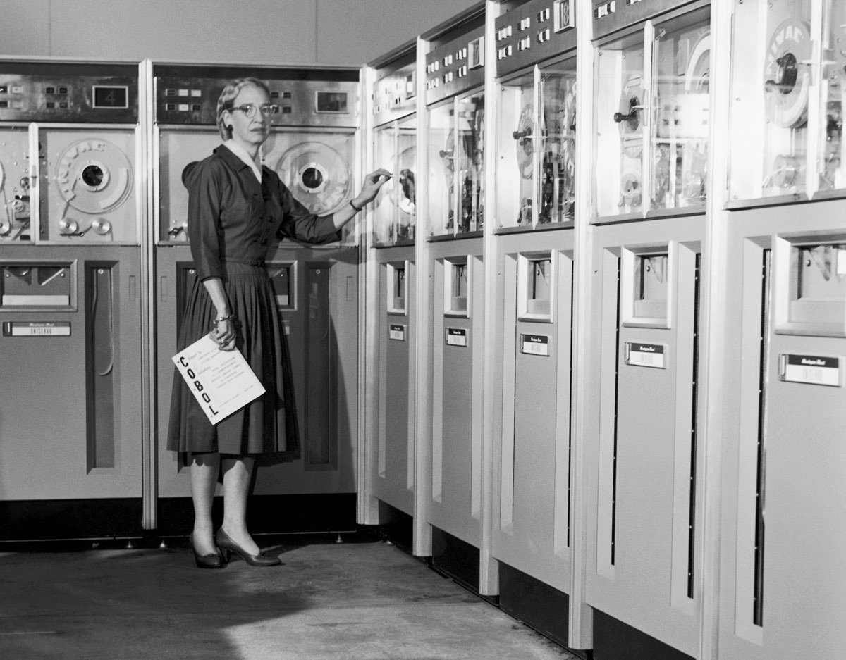 Photo of Grace Hopper with COBOL manual