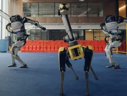 3 robots dancing in a warehouse